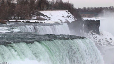 Water rushes over Niagara Falls in winter Footage