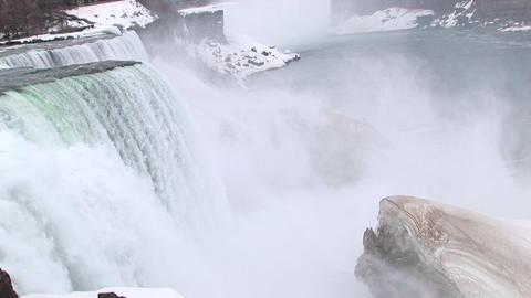The camera looks down on Niagara Falls with a large ice... Stock Video Footage