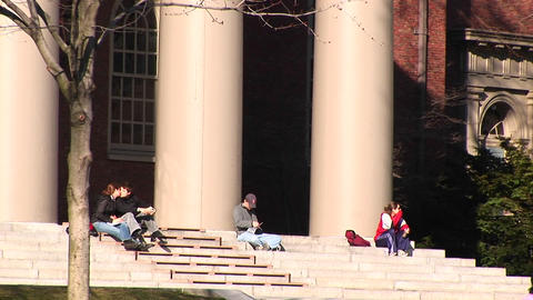 Students sit on the steps of the church at Harvard... Stock Video Footage