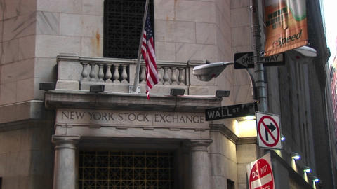 The New York Stock Exchange and the Wall Street sign in... Stock Video Footage