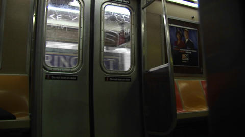 The subway train doors close and the train leaves the... Stock Video Footage