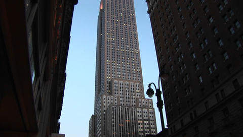 Camera gives worms-eye view of the Empire State Building as it pans to the very top of the famous st Footage