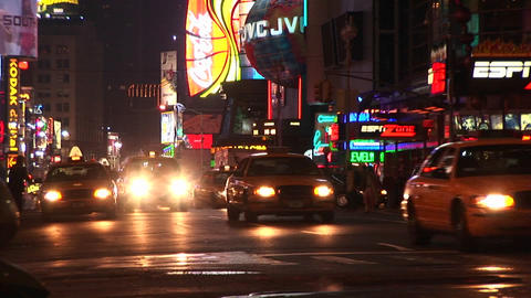 A one-way street in New York after dark with a multitude of lights Footage
