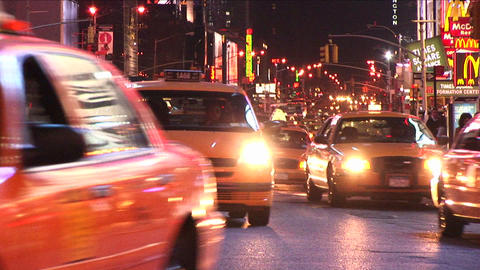 Yellow taxis dominate the traffic scene in the big-apple Footage