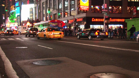 A street scene at night with traffic and lights Stock Video Footage