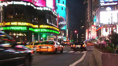 A city scene at night with traffic and pedestrians Stock Video Footage