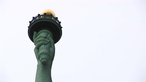 The camera pans from the head and crown of the Statue of... Stock Video Footage
