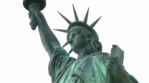 Worms-eye view of the top half of the refurbished Statue of Liberty with the tablet she holds in one Footage