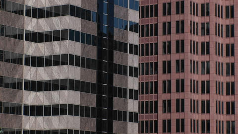 An interesting look at the colors and patterns two high-rise buildings and their windows make when s Footage