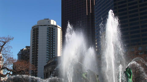 The camera pans up the Four Seasons' Fountains and the highrises in the background Footage
