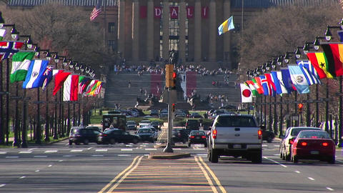 The camera pans up from the traffic and flags on Benjamin... Stock Video Footage