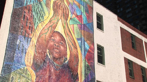 Camera pans up to reveal a colorful mural on an... Stock Video Footage