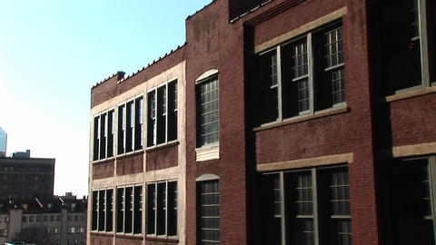 The camera zooms in on old red brick inner-city school... Stock Video Footage