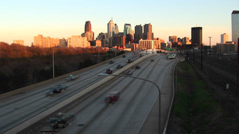 Chicago glows during the golden-hour as traffic enters... Stock Video Footage