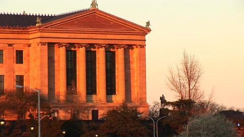 Neo-classic building with ionic columns glows in the golden-hour Live Action