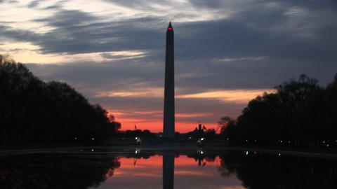 A golden-hour shot of the Washington Monument in silhouette Stock Video Footage