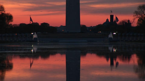 A still mirror image of the Washington Monument and the Reflecting Pool creates a stunning golden-ho Footage