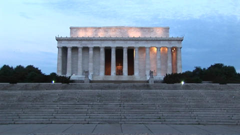 A distance shot of the Lincoln Memorial during golden-hour Footage