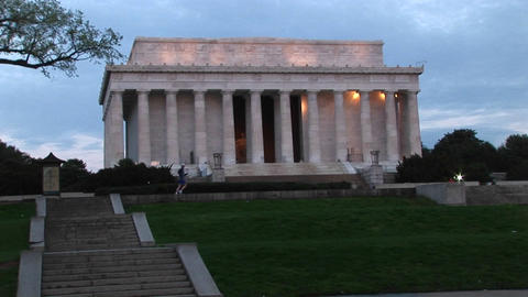 A jogger passes in front of the historic Lincoln Monument in Washington, DC Footage