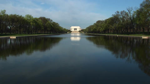 Long-shot of reflecting pool and Lincoln Memorial on the National Mall in Washington, DC Footage