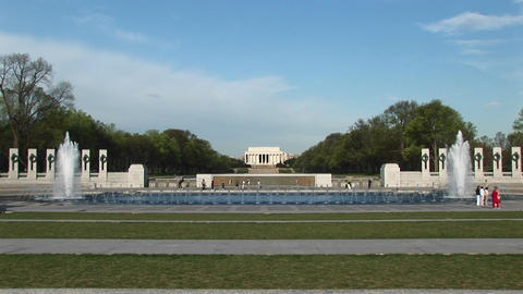 A beautiful view of the Lincoln Memorial in the distance with the reflecting pool and fountains in t Footage
