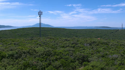 Aerial - Mobile phone base station standing just above the campsite near the sea Footage