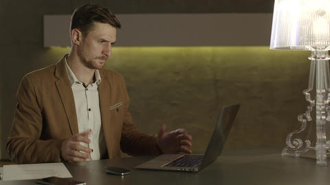 Businessman looking with amazement at his laptop computer Footage