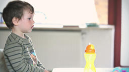 Side view of little boy watching TV Footage