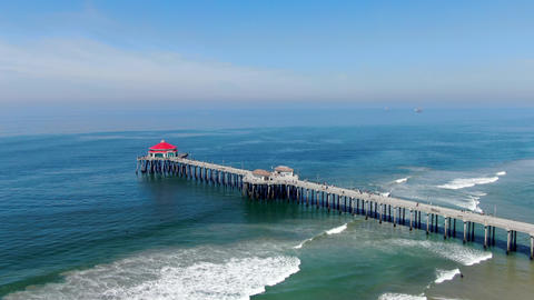 Aerial view of Huntington Pier, beach and coastline during sunny summer day Live Action