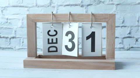 wooden calendar set on the 31 of December Live Action