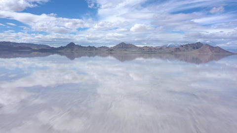 Flying fast over the Bonneville Salt Flats under water Live Action