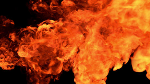 The appearance of a bright orange flame on a black background HD Live Action