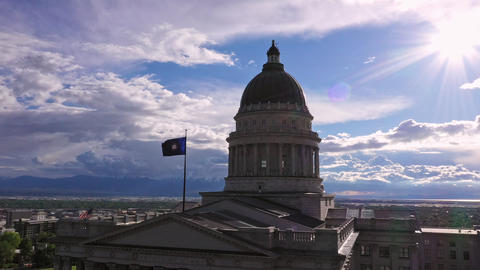 Rotating aerial view around the State of Utah Capitol building viewing the sun Live Action