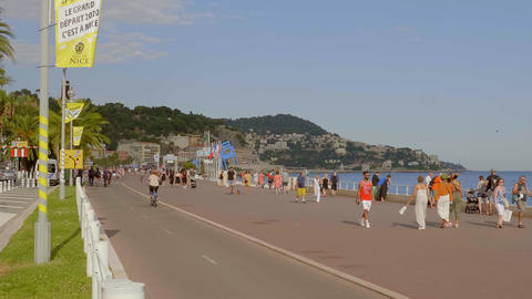 The promenade in Nice is a popular place in summer - CITY OF NICE, FRANCE - JULY Live Action