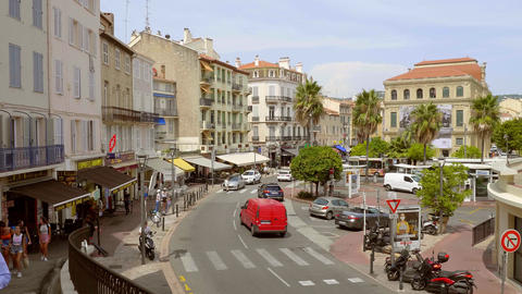 Street view in the city of Cannes on a sunny day - CITY OF CANNES, FRANCE - JULY Live Action