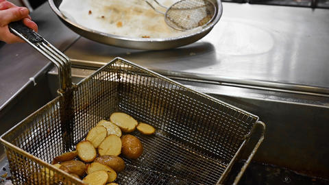 Preparing potatoes in deep fryer with boiling oil GIF