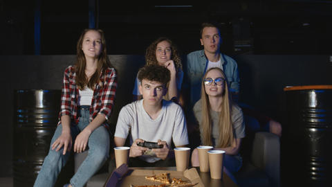 Group on upset friends are losing video games at home GIF