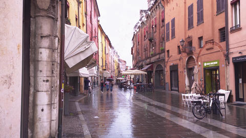 Evocative view of a street in the historic center of Ferrara Live Action