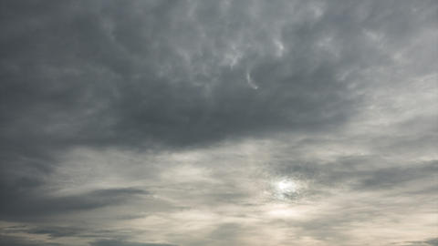 Time lapse of majestic gray cloudy sky with sun over horizon. No birds, no Live Action