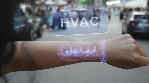 Female hand activates hologram HVAC Live Action