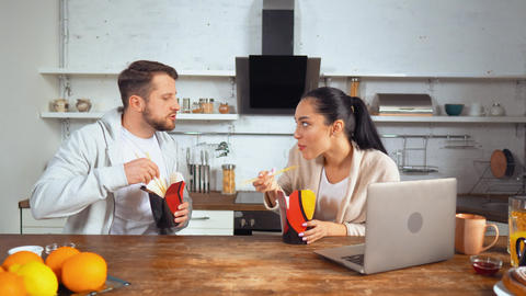 Female and male workers eating Asian cuisine Live Action