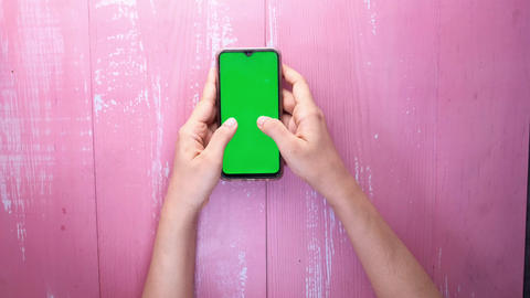 Top view of women hand using smart phone with green screen Live Action