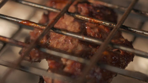 Meat grilling. Pices on grill grate. Slow motion Live Action