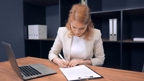 Pretty Middle-Aged Lady Doing her Work in Office Live Action
