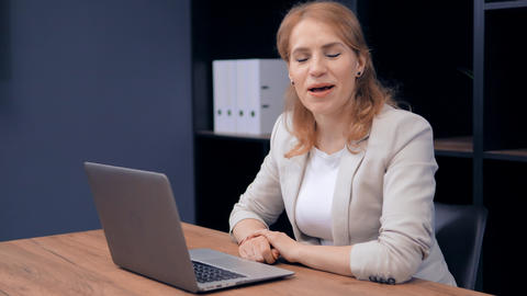 Attractive Business Woman Answering Questions on Workplace Live Action