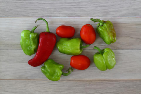 green pepper, tomato, red pepper on a brown wooden background top view, fresh vegetables フォト