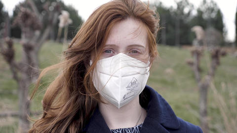 Girl in a medical respirator outside close up Live Action