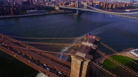 Aerial Real Time View of Brooklyn Bridge with American Flag Flapping in the Wind 2 Live Action