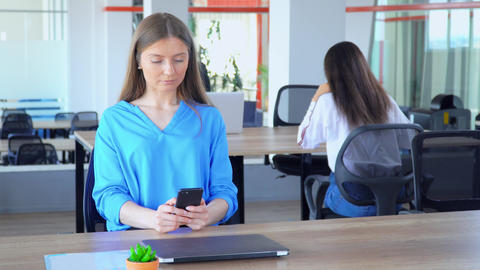 business woman using smart phone at workplace Live Action