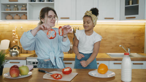 Multinational family. Interracial mother and daughter together make vegetarian Live Action